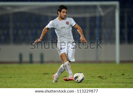 CHONBURI,THAILAND-SEPTEMBER18:Mahmoud Khadouj of Al Shorta (SYR) for the ball during the AFC CUP quarter finals between Chonburi fc.and Al Shorta (SYR) at Chonburi Stadium on Sep18,2012 in Thailand - stock photo