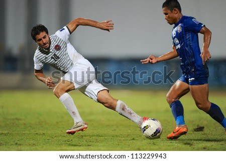 CHONBURI,THAILAND-SEPTEMBER18:Mahmoud Khadouj(white)of Al Shorta (SYR) in action during the AFC CUP quarter finals between Chonburi fc.and Al Shorta(SYR)at Chonburi Stadium on Sep18,2012 inThailand - stock photo