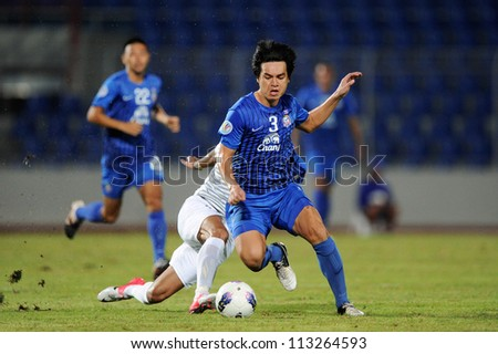 CHONBURI,THAILAND-SEPTEMBER18:Natthaphong Samana (blue)of Chonburi fc in action during the AFC CUP quarter finals between Chonburi fc.and Al Shorta(SYR) at Chonburi Stadium on Sep18,2012 in Thailand - stock photo