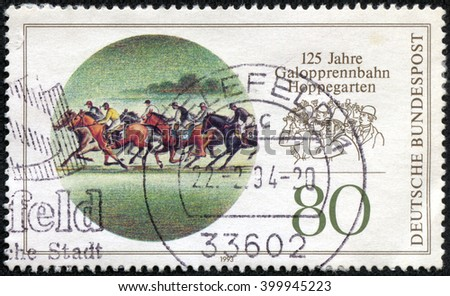 CHONGQING, CHINA - April 13, 2014:A stamp printed in Germany, shows Dahlwitz Hoppegarten (Hippodrome), Berlin, 125th Anniv., circa 1993 - stock photo