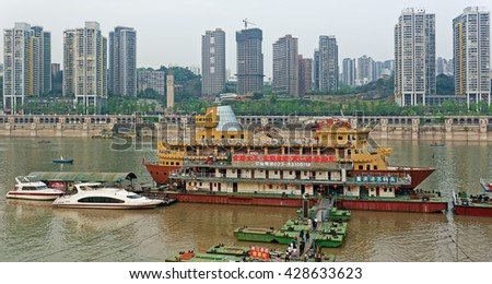 CHONGQING, CHINA â?? April 13, 2016: Chinese tourist boats on Yangtze river. The 6300km long Yangtze is the largest river in China, flowing through 11 provinces. - stock photo