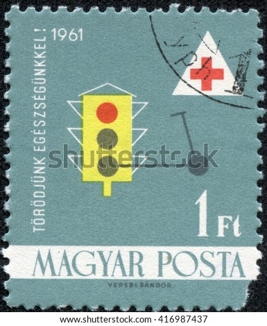 "CHONGQING, CHINA - May 9, 2014:a post stamp printed in HUNGARY shows an image on medical theme, the series ""Health Care"", circa 1961 - stock photo"