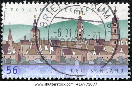 CHONGQING, CHINA - May 8, 2014:A stamp printed in Germany, shows the Town of Deggendorf, circa 2002 - stock photo