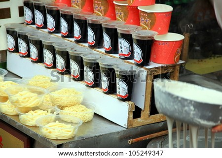 CHONGQING - MARCH 19: A noodles maker selling in a street on March 19, 2012 in Chongqing. The earliest written record of noodles is from a book dated to the Eastern Han Dynasty period (25-220). - stock photo