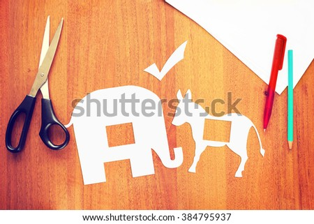 Choose between Democrats and Republicans in the elections. Conceptual image with paper scrapbooking - stock photo