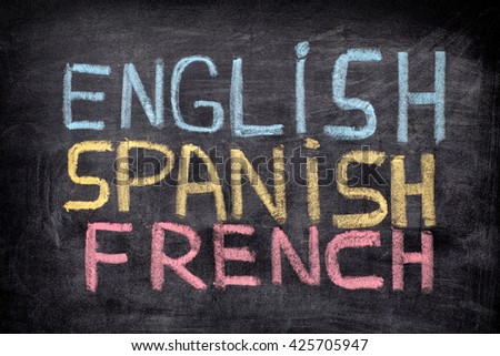 Choose your language. Words English, Spanish, French drawn on blackboard. Close up. - stock photo