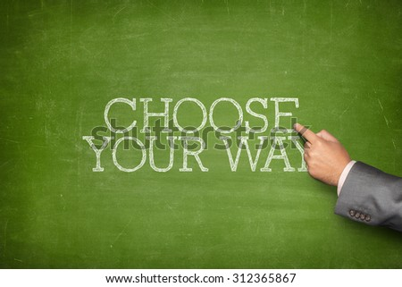 Choose your way text on blackboard with businessman hand pointing - stock photo