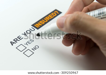 Choosing between yes or no to be insured - stock photo