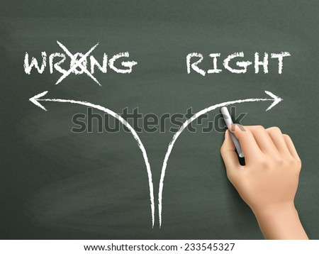 choosing the right way instead of the wrong one on blackboard - stock photo