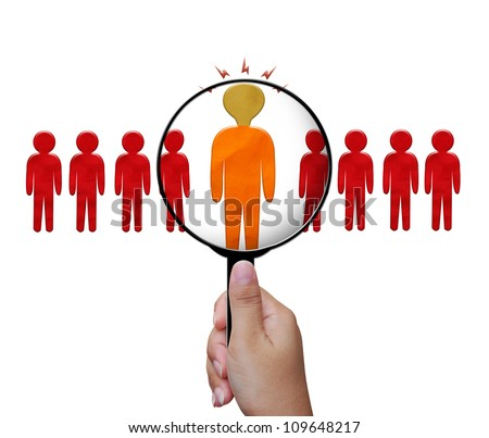 Choosing the talent person for hiring in magnifying glass - stock photo
