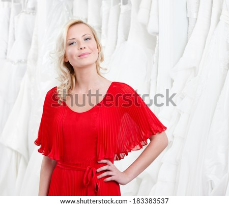 Choosing wedding gown girl imagines herself as a bride - stock photo