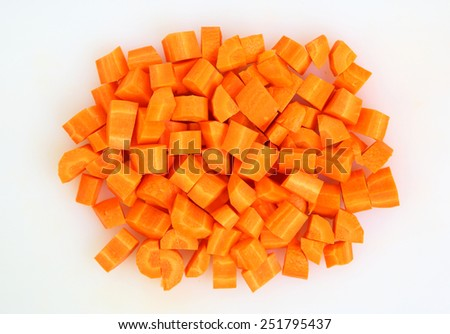 Chopped and sliced carrot on white plate - stock photo