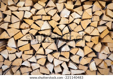 Chopped and stacked pile of pine and birch wood background - stock photo