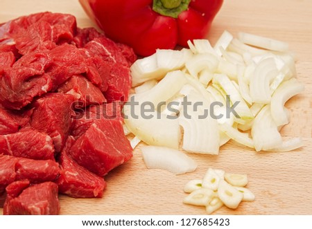 Chopped beef steak with onion, garlic and pepper - stock photo