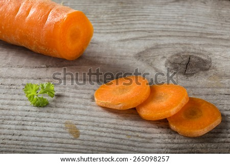 Chopped carrot on a wood board,shallow dof - stock photo