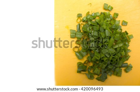 Chopped green onions on a cutting board. Photo. - stock photo