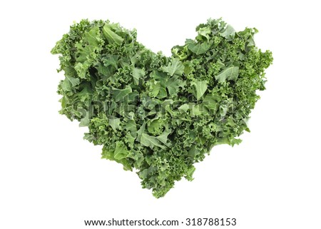 Chopped kale in a heart shape, isolated on a white background - stock photo