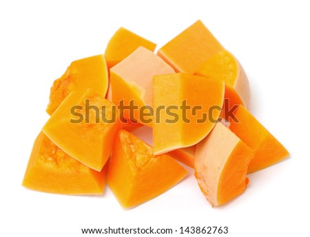 chopped pumpkin on white background - stock photo