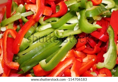 chopped red and green capsicum peppers - stock photo