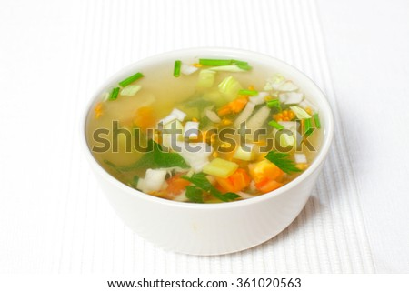 chopped soup ingredients: carrots, onions and celery cooking in a stainless steel pot - stock photo