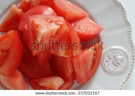 chopped tomato on white dish - stock photo