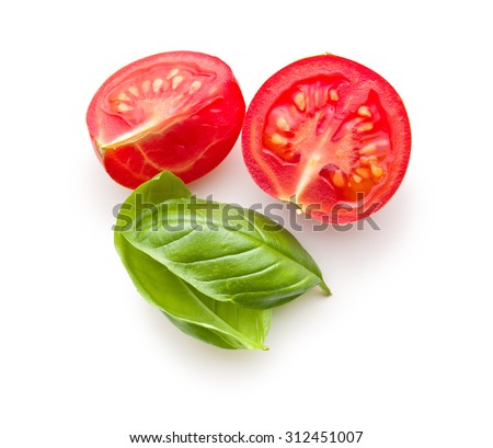chopped tomatoes and basil leaf on white background - stock photo