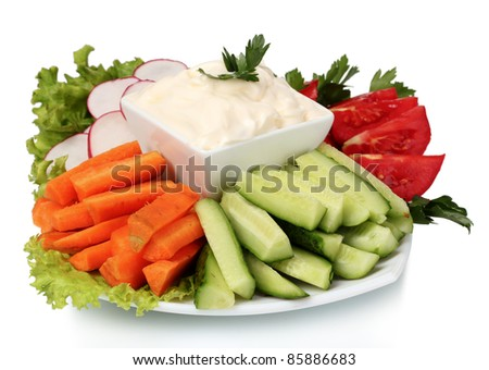 Chopped vegetables and sauce on plate isolated on white - stock photo