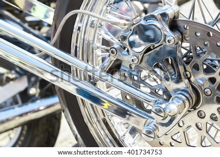 chopper motorcycle front wheel and brake assembly - stock photo