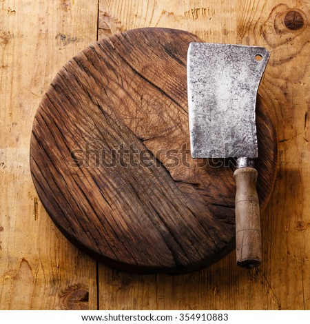 Chopping board block and Meat cleaver large chef's knife on wooden background - stock photo