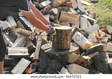 Chopping wood - fuel and ax - stock photo