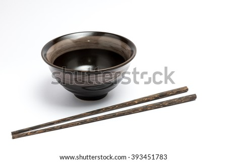 Chopsticks and japanese style bowl isolated on white background - stock photo