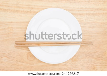 Chopsticks and plate - stock photo