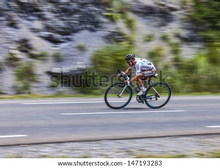 CHORGES, FRANCE- JUL 17:Panning image of the French cyclist Samuel Dumoulin pedaling during the stage 17 of 100th edition of Le Tour de France, a time trial between Embrun and Chorges  on July 17 2013 - stock photo