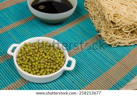 Chow mein noodles, soy sauce and soy beans, Asian food ingredients - stock photo