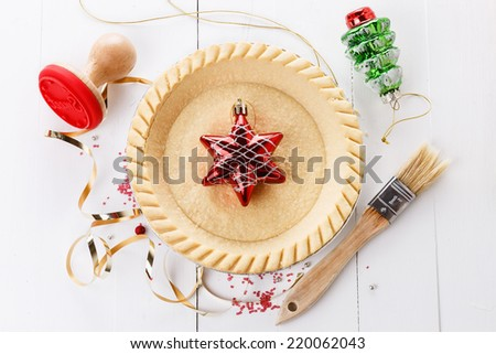 Chrismas baking concept. Tart base and utensils over white wooden background. Top view - stock photo