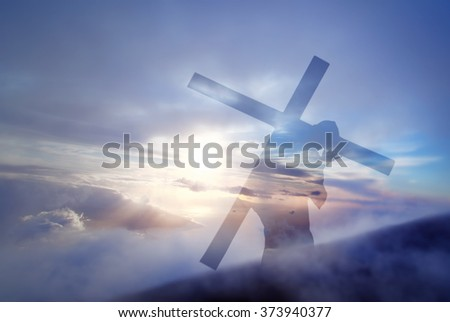 Christ carrying cross up Calvary on Good Friday over bright sky  - stock photo