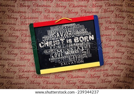 Christ is born Religious Words on black board - stock photo