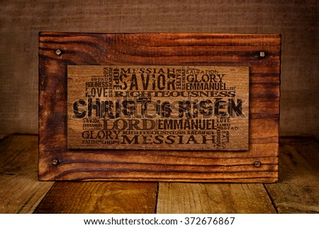 Christ Is Risen  Religious Words on wood plate - stock photo