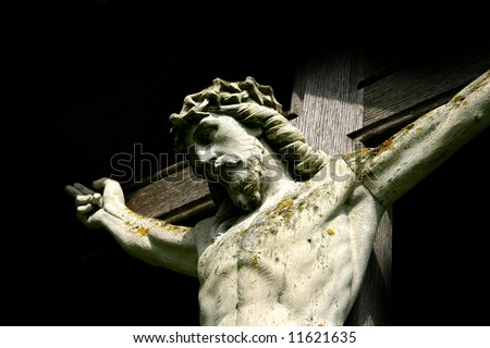 Christ's on the cross set against a black background for  use as a Christian symbol, especially at Easter time. - stock photo