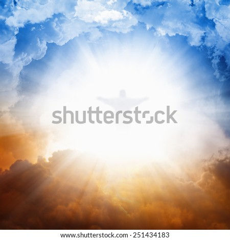 Christ silhouette in sky , bright light from heaven, blue and red clouds - stock photo