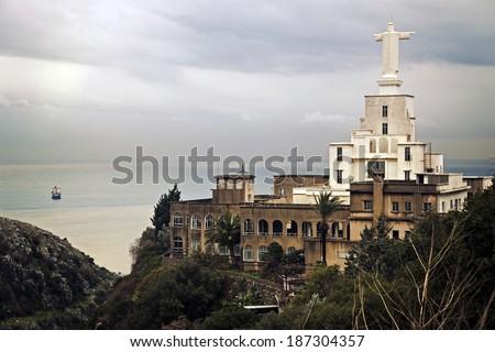 Christ statue on the church - Nahr al-Kalb, Lebanon - stock photo