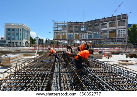CHRISTCHURCH - DEC 07 2015:Builders builds a new building in Christchurch.Over 1000 buildings in the CBD (Central Business District) were demolished following Christchurch earthquakes - stock photo