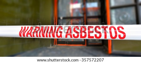 CHRISTCHURCH - DEC 04 2015:Sign reads: Warning - Asbestos removal in progress.Inhalation of asbestos fibers can cause serious and fatal illnesses including lung cancer, mesothelioma and asbestosis. - stock photo