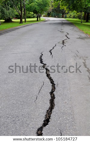 CHRISTCHURCH, NEW ZEALAND - FEBRUARY 23: Cracks appear in Mona Vale gardens beside the Avon River following a giant earthquake on February 23, 2011 in Christchurch. - stock photo