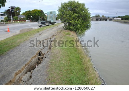 CHRISTCHURCH, NEW ZEALAND, FEBRUARY 26, 2011 - Damage to a footpath near the Avon River from 6.4 earthquake in Christchurch, South Island, New Zealand, 22-2-2011 - stock photo