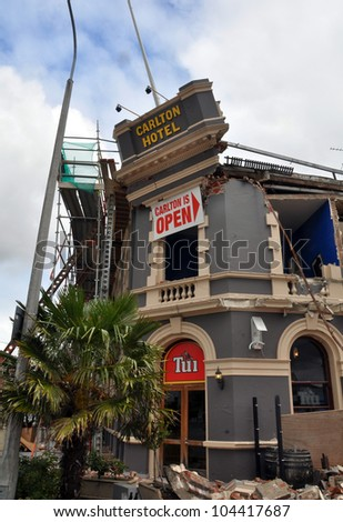 CHRISTCHURCH, NEW ZEALAND - FEBRUARY 23: The iconic Carlton Hotel is destroyed by a huge earthquake on February 23, 2011 in Christchurch, New Zealand. - stock photo