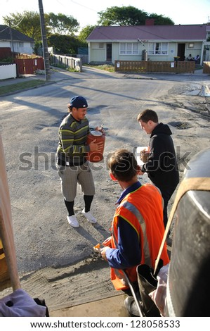 CHRISTCHURCH, NEW ZEALAND, FEBRUARY 26, 2011 - Volunteers bring water to the suburbs after the 6.4 magnitude earthquake in Christchurch, South Island, New Zealand, 22-2-2011 - stock photo