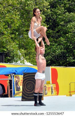 CHRISTCHURCH, NEW ZEALAND - JANUARY 22: Acrobats Mim and Danny perform at the 20th World Buskers Festival on January 22, 2013 in Christchurch. - stock photo