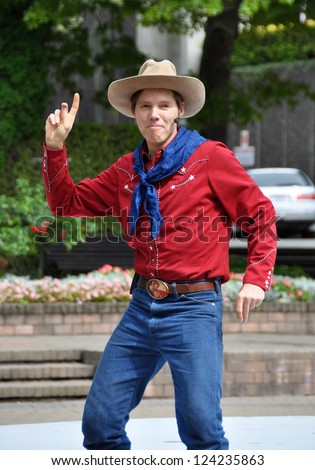 CHRISTCHURCH, NEW ZEALAND - JANUARY 23, 2011: Texas entertainer Shelby Bond, also known as Cowboy Max strikes a pose at the at the 18th World Buskers Festival on January 23, 2011 in Christchurch. - stock photo