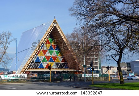 CHRISTCHURCH, NEW ZEALAND - JUNE 23, 2013: Christchurch Earthquake Rebuild - New stained glass windows are installed in the Cardboard Cathedral in Latimer Square on June 23, 2013 in Christchurch. - stock photo